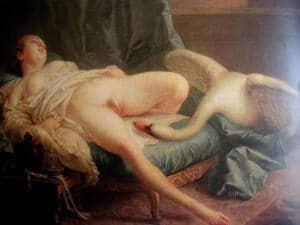 Cuadro de Leda sobre la cama desnuda de cintura para abajo y con el cuello del cisne entre las piernas