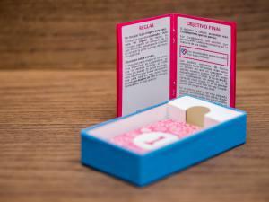 Cartas Coupletition dentro de la caja